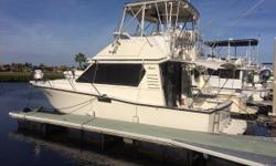 You can Fish it, you can Cruise it, you can Live Aboard! Rugged Hunt designed deep V has spacious accommodations. Her rich teak varnished interior boast a roomy salon with sofa bed and a very large galley dinette that converts to a bed. Private owner's