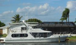 This 48 Bluewater Coastal Cruiser is powered by twin Cummins Diesel engines. The single level layout provides full visibility from front to back with a huge living area, and there is a large Sun Bridge. The hull design provides a smooth, steady ride