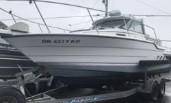 REDUCED PRICE 1992 Bayliner 22 HT Trophy Has Water In Engine!!! This 1992 Bayline 22' Hard Top Trohpy is for sale as is at our Coos Bay location for just $5,995 . The good : This boat has tall bow rails, an electric anchor wrench, in floor deck fishboxes,
