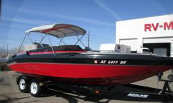 POWER!! COMFORT!! EYE APPEAL!! This 1992 Carrera 22? Viper is sure to satisfy your need for speed with it?s 7.4ltr Mercruiser V8 engine/Bravo One outdrive/310 HP! There plenty of seating on the well preserved vinyl and shade from the sun with the matching