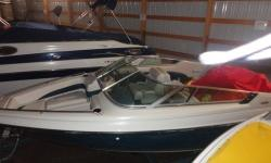 1992 Crownline 196 with Mercruiser 5.0L LX and tandem trailer.