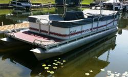 Value priced 24' pontoon w/ Evinrude 30Hp, great family cruising pontoon, 16 person capacity, vinyl good throughout, upgraded individual seat covers, motor has been recently serviced, stereo works, docking lights. Great boat to put you on a cruising lake