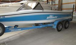 Clean! PCM V8, tandem axle trailer. Beam: 7 ft. 3 in. Hull color: Blue