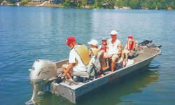 HONDA 4-STROKE TILLER MOTOR, STARTING & ACCESSARY BATERRIES. INSTRUMENMT/SWITCH PANEL WITH MOTOR TACH, TRIM AND FUEL GAGES. NAVIGATION LIGHTS (BOW & STERN LIGHTS; LIVE WELL & BILGE PUMPS. ROD LOCKER AND BOW STORAGE AREAS MINN KOTA TURBO POWER