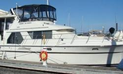CUMMINS DIESELS - LOWER HELM OPTION - STACK WASHER & DRYER - AND MUCH MUCH MORE!! The Carver 440 Aft Cabin Motor Yacht has everything you could want in a motor yacht of this class. Topside, the 440's bridge offers comfortable seating for seven. She has a