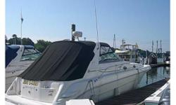 This nearly perfect 1994 Sea Ray Sundancer is located in Greenwich, CT.  She is in the water and ready to cruise with her new owner or captain at the helm.  She is powered by twin 454 Mercruisers with only 460 hours of light use on them. Her