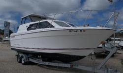 This 1994 Bayliner 2859 Classic has low hours and has been kept in great shape!!! Has a hard top with hard walls on 3 sides of the cockpit. This is the perfect family fishing/cruising/camping boat. Plenty of deck space with a large walkthru to the