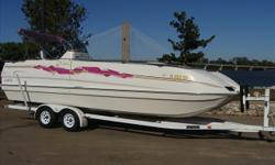 """This is a very unique deck boat. She has a catamaran style hull for a great ride, front seats turn into loungers facing front or rear and virtually a full """"basement """" for storage. Want for info, just give us a call 1 800 357 7096. Thanks, John Archer"""