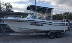 1994 Grady White 225 Dual Console with custom top, Yamaha 250 HP, and trailer. Nicely equipped with a custom eosin glass enclosure, boat cover, on board battery charger, Garmin GPS depth sounder, stereo system, swim platform w/ boarding ladder and
