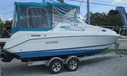 1994 RINKER 265 FIESTA VEE / MERC. 5.7L V-8 BRAVO / 2006 ALUMINUM TRAILER PACKAGE This 26? Rinker cruiser is the perfect family fun in the son weekend getaway machine! This package includes a Mercruiser 5.7L V-8 motor with the Bravo drive system, full