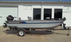 1994 Tracker Sweet 16 tiller equipped with Mercury 40 hp outboard motor and Motor Guide Pro Series 12V trolling motor with 30 lbs. thrust. Boat includes wind guides, livewell and single axle trailer. 6 person capacity. Please call before coming to view as