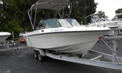 1995 Sport craft 202 dual console, bimini top, galvanized double axle trailer, fish finder, 152 Garmin GPS , stereo seaworthy CD, 200 hp Mariner engine, stainless prop, bait wells and a flip flop cooler seat. Category: Powerboats Water Capacity:  Type: