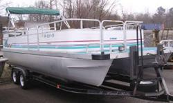 1995 LOWE 24' PONTOON THIS IS A USED 1995 LOWE 24' PONTOON. THIS BOAT INCLUDES A 1996 JOHNSON 70HP ENGINE, AND A TANDEM AXLE HAUL RITE TRAILER. ALSO HAS A REAR ENTRY LADDER. THE FRONT FOLD-DOWN SEATS CAN BE MOVED FROM INSIDE THE RAILING ONTO THE FRONT