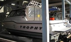 1995 Bayliner Trophy 2352 Walkaround Powered by a 2004 Mercruiser 350 Magnum Engine; Bottom Paint; Trim Tabs; Full Swim Platform with Ladder; Hard Top with Full Cockpit Enclosure; Captain?s Chair; Downriggers; Rod Holders; Live Well; Fresh Water Wash