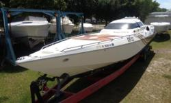 (LOCATION: Clearwater FL)    OWN A SERIOUS OFFSHORE MONOHULL RACING BOAT -  This 46' Cougar Custom Offshore Racer is available now.  Hull only with 53' trailer included.    This boat's story is described