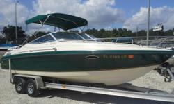 It's a Sport Cruising Cuddy powered by a Mercruiser 454 7.4 L V8 Gas engine with a Bravo 3 outdrive. It has big direct exhaust, or with the push of a button you can select the Silent Choice exhaust which runs the exhaust through the outdrive.