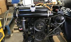 For sale is a Mercruiser 5.7 Bravo inboard. 350 CD 250 Horse Power. Thunderbolt ignition with power steering. Four-Barrel carburetors New Seakamp Engineering Inc. Heat Exchangers Coolant recovery system Also Included - Gear Lube Reservoir Bottles with