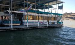 Well kept, nice, fully functioning houseboat. Everything is included, well stocked with all gear including live Jackets and fishing gear, all furniture, dock fixtures as well as a really nice 1988 SunTracker 24 Party Barge with 115 EFI Mercury Four