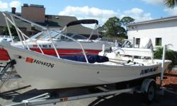 1996 CUSTOM SKIFF GREAT FAMILY BOAT W/ 2007 EVINRUDE 90 H.P. W/40 HOURS CUSTOM SUN LOUNGE ON FRONT MAGIC TILT ALIMINUM TRAILER Category: Small Boats Water Capacity:  Type: Skiff Holding Tank Details:  Manufacturer: #1 Hull Holding Tank Size:  Model: