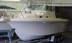 This Pro Line is in good shape for its age. The hull is a 1996 and the 4 strokes are 2005. It has an engine bracket and pulpit. The gelcoat is in very good condition. No bottom paint. The upholstery has been redone. Props are top of the line Stainless 4