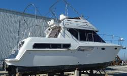 - - - Wholesale Pricing - - - - - Offered now, to be Ready for spring launch - - The Carver 325 has a very versatile layout providing very comfortable sleeping for six and ample storage space for all aboard.The master stateroom features both a