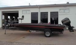 Cobra 19' dual console bass boat with a Johnson 200 hp engine with a jack plate. It is sitting on an EZ Loader trailer and has Motor Guide Brute 750 trolling motor. It also has large rod lockers and two depth finders. There is a lot of storage in the
