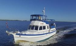 She is the Cleanest and Nicest One on the Market, Twin 210hp Cummins Diesels, 7.6kW Westerbeke Genset, Complete Electronics Package, Bimini Top with Full Enclosure with Aft Sun Top, Teak Walk Around Decks Removed!! Very Nice Vessel. Just Reduced to