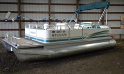 1996 Sylvan Elite 20 Pontoon & 60HP Mercury Outboard. Motor Runs Great! This Pontoon Features Front Deck With Seat Bases, Two Front Seats, Flip Back Seat With Storage, Rear Bench Seating With Storage, Swivel Helm Seat, New Pyle Radio With USB Port And AUX