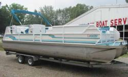 """This 24' JC Tri-toon """"Suntoon 24"""" has a 70hp Evinrude, and a tandem axle Hoosier trailer. Includes docking lights, 2 tables, rear entry with swim ladder, and a mooring cover. 16 person capacity! Clean interior and runs great!! Beam: 8 ft. 5 in. Stock"""
