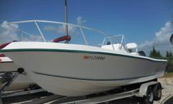 This 1997 Mako Marine 221 CC Center Console boat is 22 feet in length. Features include Standard Horizon Eclipse Marine Band Radio, CD Player and Mako Compass. Powered by a 1997 Mercury 225XL Offshore Series motor. A Continental Tandem Axle Trailer