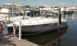 """Roomy, open floor plan with 13'6"""" beam in this clean, well kept express featuring preferred Cummins diesels. Spacious cockpit w/wet bar, updated electronics, autopilot, full canvas package. Full canvas package. Great two couple cruising boat or"""
