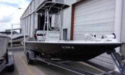 Completely refinished 21 Champion Release bay boat with a 2004 Yamaha VZ200 and Loadmaster aluminum trailer. Price includes trolling motor (runs only on high speed), T-top, jackplate, trim tabs, hydraulic steering, new leaning post and swim