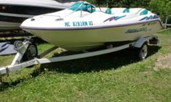 Go on your favorite lake and cruise around. This sporty boat is agile and fun to drive. There is a Shorelander trailer. Beam: 7 ft. 1 in. Hull color: white Boat cover;