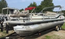 Check this one out! 27 foot pontoon with a built in bar! This has TONS of storage and TONS of seating! Powered by a Mercruiser inboard 3.0L, engine runs fine, compression is good, outdrive gear lube checked and changed. All aluminum decking. Very nice