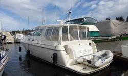 Great boat at an attractive price that is ready to cruise!  She boasts a large cockpit with seating for four around her optional hydraulic table and a huge salon with lounge below for additional space entertaining.   Twin low hour Caterpillar