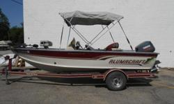 1998 Alumacraft T-Pro 175 CS equipped with Yamaha 130 hp 2 Stroke outboard motor and Minn Kota Power Drive 24 V trolling motor with 70 lbs thrust. Boat includes bimini top, livewell, radio, battery charger, rod storage and single axle trailer. 5 person