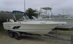 In Pensacola FL. This 1998 Aquasport 215 Dual Console is outfitted with a 200hp Evinrude, removeable cobia tower, fish finder, GPS, VHF and a galvanized trailer. Options and Features include; Bimini Top, Boat cover, coaming pads, Bait Well, rear jump