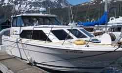 1996 Bayliner Marine Corp Ciera Series 2859 Express Cruiser 1996 Bayliner Pilothouse Cruiser with 3-axle King trailer with disc brakes and 2 spare tires. Hull extended below swimstep to accommodate transmission which is 4 feet long when boat was repowered