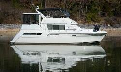 1998 Carver 405 Aft CabinFreshwater Motor YachtThis beautiful, spacious yacht has been used only in freshwater and has been stored under cover for her entire life. The light finished wood interior makes her salon light and airy. The two cabins (each with