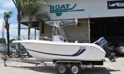 READY TO RIDE 1998 Cobia 244 Excelent financing available 1998 225 Yamaha OX66 1998 Double axle aluminum trailer Stock # 8271 The 1998 Cobia 244CC is offshore/inshore Fish ready! Brand new floor Yamaha Saltwater Series II Center Console  T-top Dual
