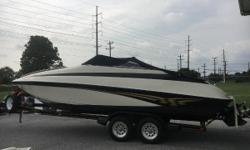 """The galley of the Crownline 248 CCR includes a sink and can be outfitted with optional alcohol or alcohol - electric stove. The portable head stows in the starboard cabin area, and has a privacy curtain. The 248 CCR has a standard """"laser wave"""" helm with"""