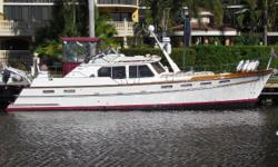 "Just Reduced to $169,950.00 This two stateroom, two head vessel is the best of all worlds for the traveling boater. Single Cummins 6BT, Bow Thruster, Onan 12kW Generator less than 400 hrs, Shallow Draft with 3/8"" Stainless Steel Bottom Plate over"