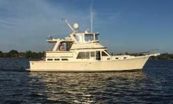 """The Offshore 48 Yachtfisher is a traditional double-cabin design with a trawler-style appearance and a practical cruising layout. Her low- freeboard modified-V hull is cored from the chine up, and her 15' - 6"""" beam is about average for her size."""