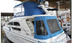 1998 Sealine F-44 Flybridge located in Jacksonville, FL Sealine has often been noted for their excessive styling, and the 44 Flybridge is a very distinctive yacht by the standards of her day. Built in England, she rides on a solid glass modified-V hull
