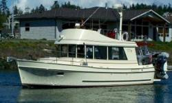 Fresh water kept under cover its entire life this fine example offers economical cruising, powered by an 200 Hp Volvo Diesel engine, Keypower bow thruster, Webasto forced air heat, redundant electronics at both helms, an AR 9.5 tender with a 9.5 Hp Suzuki