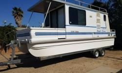 1999 Catamaran Lil Hobo Deluxe Houseboat New custom install Onan Generator 2800 New Brakes drums bearings actuator New crank stand jack cranks with ease New Refrigerator never used just installed- 6 cubic ft New Marine GPS never used New Blinds for front