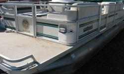Budget Pontoon in over all good condition. Nominal Length: 22' Length Overall: 22' Beam: 8 ft. 6 in.