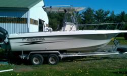 This value priced center console has a super wide beam and offers more cockpit fishing space than most 23-footers. Her deck layout has forward fish boxes, tackle storage drawers, console head compartment, above deck livewell, transom rigging station with