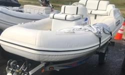 JET MOTOR, RUBBER BOAT. CLEAN WITH TRAILER!