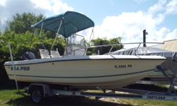 1999 Sea Pro 190, This is a clean 1999 Sea Pro 190 Center Console With 115 HP Everude SPL motor, Green Bimini, Bimini Boot, live well, fish box, Plenty of rod holders and rod storage. 2 Pedestal Seats, compass, comes with trailer and much more...Located